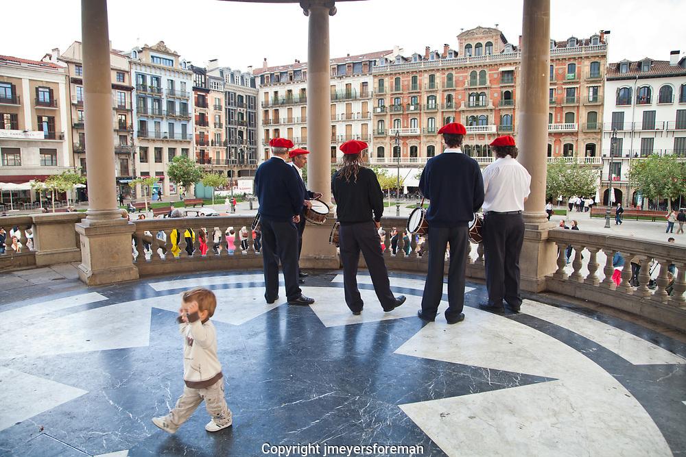 little boy dances as Basque Musicians in the Plaza del Castilio
