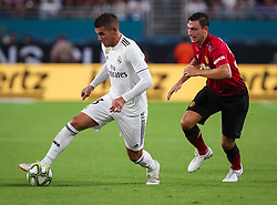July 31, 2018 - Miami Gardens, Florida, USA - Real Madrid C.F. defender Theo Hernandez (15) (left) drives the ball past Manchester United F.C. defender Matteo Darmian (36) (right) during an International Champions Cup match between Real Madrid C.F. and Manchester United F.C. at the Hard Rock Stadium in Miami Gardens, Florida. Manchester United F.C. won the game 2-1. (Credit Image: © Mario Houben via ZUMA Wire)