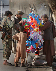 KANDAHAR,AFGHANISTAN - SEPT.6 :  Afghans look at balloons near the old Governor's mansion September 6, 2002 in Kandahar, Afghanistan. The city remains tense after Kandahar Governor Gul Agha Sherzai was shot during an apparent assassination attempt on President Hamid Karzai yesterday evening. .(Photo by Ami Vitale/Getty Images)