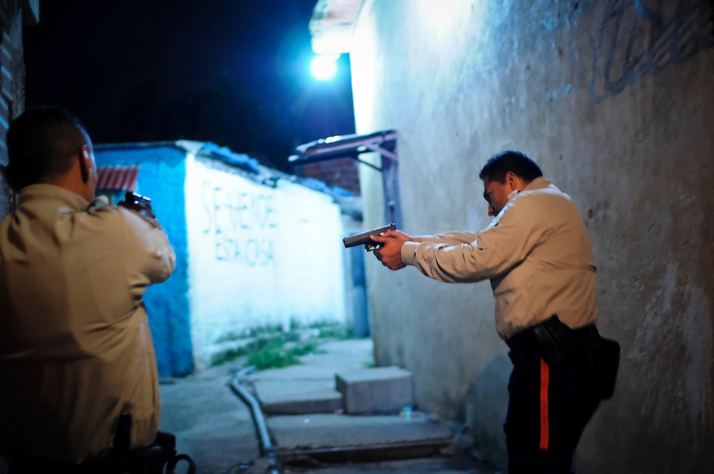 Members of a special tactical division of the Sucre police force conduct a late night foot patrol in Petare. The Petare slum is one of the most violent areas of Caracas, Venezuela, reporting over a dozen homicides every weekend. According to the ngo, the Venezuelan Observatory of Violence (OVV), Caracas has one of the highest violent crime rates in the world, with two people murdered every hour, a homicide rate that has quadrupled over the eleven year presidency of Hugo Chavez. Equally disturbing is the level of impunity, corruption and incompetency in the Venezuelan judicial system. OVV reports that 91% of crimes go unsolved in Venezuela.
