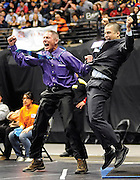 Middle Park wrestling coaches Cal Cherrington, left, and Cody Arnold celebrate as Brian Macchione wins the class 3A 189-pound championship at the Colorado High School State Wrestling Tournament on Feb. 19 at the Pepsi Center in Denver.