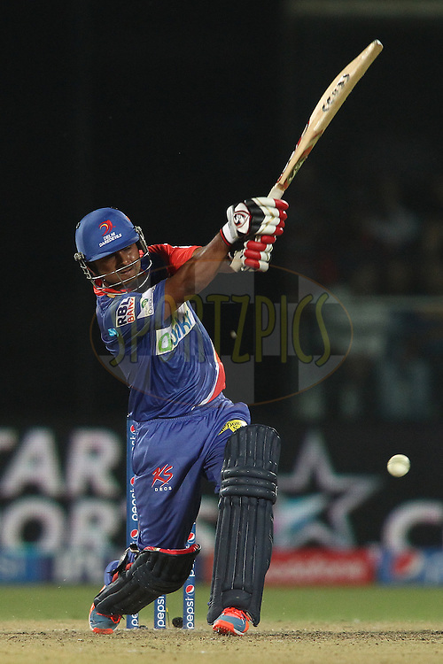Kedar Jadhav of the Delhi Daredevils attacks a delivery during match 26 of the Pepsi Indian Premier League Season 2014 between the Delhi Daredevils and the Chennai Super Kings held at the Feroze Shah Kotla cricket stadium, Delhi, India on the 5th May  2014<br /> <br /> Photo by Shaun Roy / IPL / SPORTZPICS<br /> <br /> <br /> <br /> Image use subject to terms and conditions which can be found here:  http://sportzpics.photoshelter.com/gallery/Pepsi-IPL-Image-terms-and-conditions/G00004VW1IVJ.gB0/C0000TScjhBM6ikg