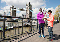 Virgin Money London Marathon 2015<br /> <br /> Winners Photocall<br /> <br /> Left to Right<br /> Eliud Kipchoge Kenya Mens winner<br /> Tigist Tufa Ethiopia Women Winner<br /> <br /> Posing with the Sporting Life Marathon Trophy<br /> <br /> Photo: Bob Martin for Virgin Money London Marathon<br /> <br /> This photograph is supplied free to use by London Marathon/Virgin Money.