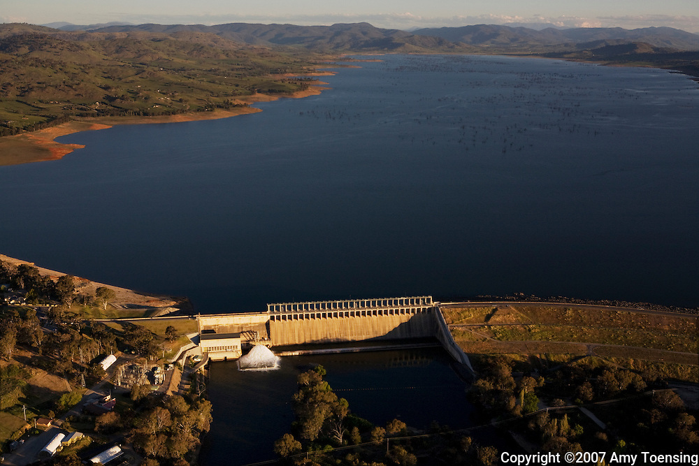 ALBURY, NSW, AUSTRALIA - OCTOBER 08: Hume Dam and Hume Reservoir with low water levels from the drought October 8, 2007 in Albury, New South Wales, Australia. This reservoir holds water for the Murray-Darling Basin Irrigation system. From here the water will travel several hundred kilometers to its mouth on the coast of South Australia in Adelaide. Along the way the water will be used by irrigating farmers. The Murray-Darling Basin of Australia has been plagued with severe drought since the late 1990's and many growers and policy makers are being forced to work on implementing more efficient irrigation systems. (Photo by Amy Toensing/Reportage by Getty Images). _________________________________<br /> <br /> For stock or print inquires, please email us at studio@moyer-toensing.com.