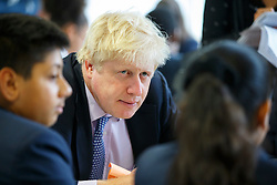 © Licensed to London News Pictures. 23/06/2015. London, UK. The Mayor of London Boris Johnson having a brunch with pupils during his visit to Michaela Community School in Wembley, north-west London on Tuesday, June 23, 2015.  Photo credit: Tolga Akmen/LNP