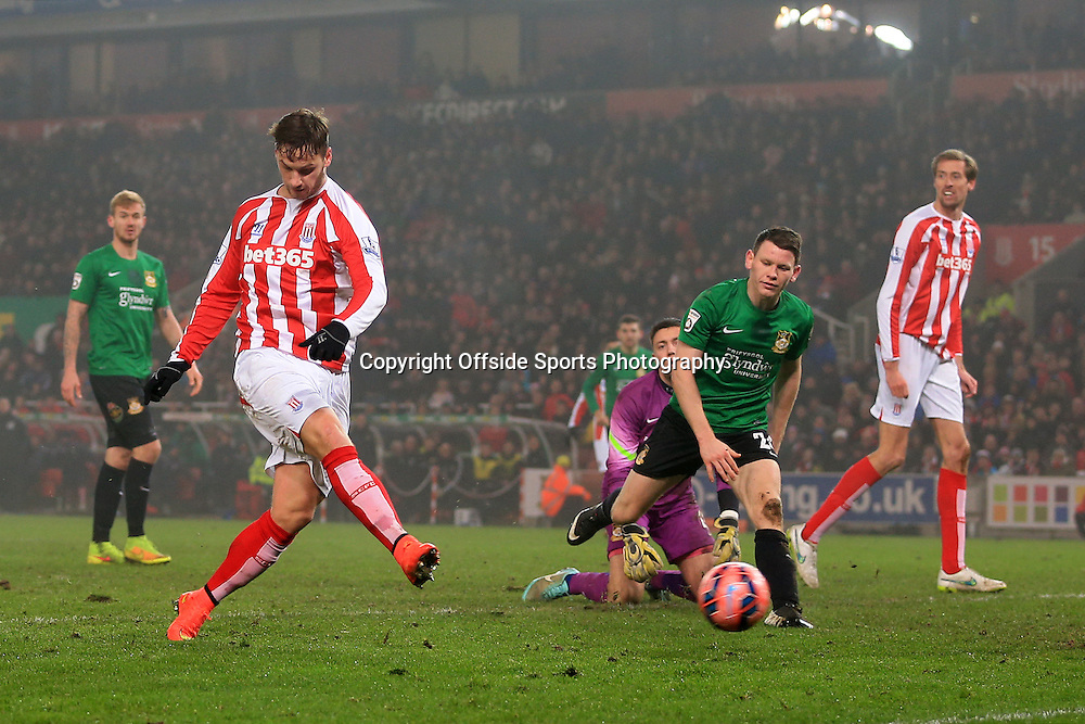 4th January 2015 - FA Cup - 3rd Round - Stoke City v Wrexham - Marko Arnautovic of Stoke scores their 1st goal - Photo: Simon Stacpoole / Offside.