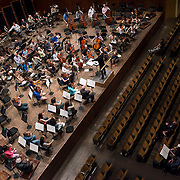 June 3, 2014 - New York, NY : Composer-conductor Matthias Pintscher, standing at center, leads the New York Philharmonic as it rehearses a piece by up-and-coming composer William Dougherty (seated in the audience at bottom right) at Avery Fisher Hall on Tuesday. Three works by little-known composers, such as Dougherty, will be selected for inclusion in the New York Philharmonic's Biennial. CREDIT: Karsten Moran for The New York Times
