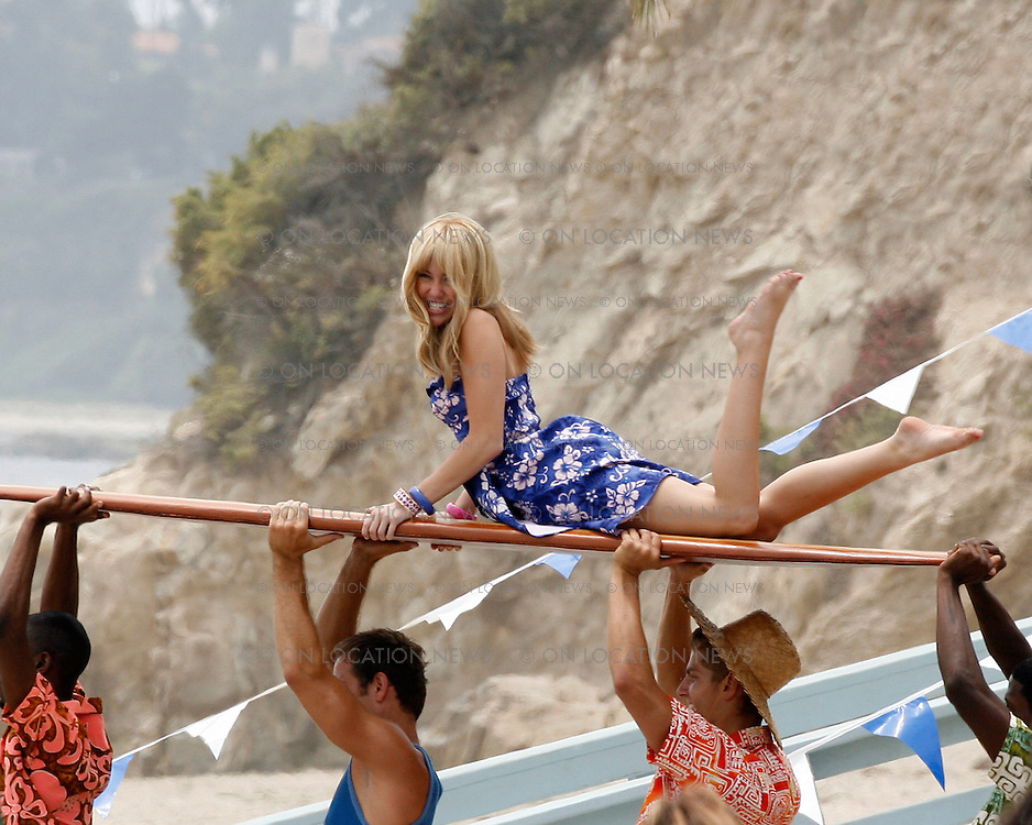 MALIBU, CALIFORNIA - THURSDAY 10TH July 2008 NON EXCLUSIVE: Miley Cyrus shooting beach scenes for her new movie 'Hannah Montana'. Cyrus was joined on set by Ugly Betty star Vanessa Williams. The scenes being filmed on the beach is for a 1960's style beach music video for the character of Hannah Montana in the movie. Photograph: On Location News. Sales: Eric Ford 1/818-613-3955 info@OnLocationNews.com