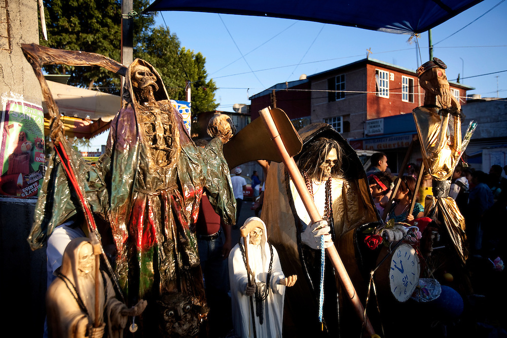 .A pilgrimage to the Santa Muerte altar at the neighborhood of Mexico city named Tepito.Mexico, Mexico City.Friday, October 1.2010..Santa Muerte (Saint Death) has been regarded as a religious cult by the Catholic Church even though some churches worship Santa Murte.The cult has been closely linked to the lower classes, crime, drugs and prostitution.The Mexican authority found many shrines built for Santa Muerte in prominent drug lords mansions. The religion is popular in poor, crime ridden neighborhoods, such as Tepito in Mexico City. The largest of the shrines in Tepito built for Santa Muerte is on Alfareria Street.On the first day of each month, worshippers come out to pray to the skeleton that the followers refer to as La Flaca (the skinny one) and La Nina Blanca (the white girl).