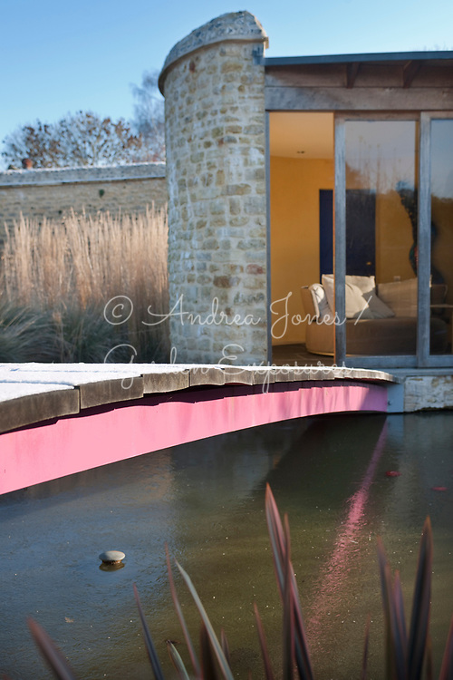 John Makepeace's studio/office with pink bridge over pond in winter