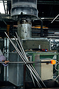 """Italy, Veneto, Canton, glassblowing factory """"Vetrofond"""" producing lamps for Foscarini, waiting for the glass to cool a bit before keeping workiing on it"""