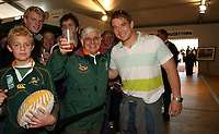 Photo: Paul Thomas/Sportsbeat Images.<br />South Africa Reception at Rugby Town. 21/10/2007.<br /><br />South African captain John Smith poses with fans at the Heineken rugby village, Paris.