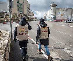 1 March 2020, Bethlehem, Palestine: Participants in the Ecumenical Accompaniment Programme in Palestine and Israel walk along a street near the separation wall in Bethlehem.