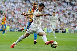 09.05.2015, Estadio Santiago Bernabeu, Madrid, ESP, Primera Division, Real Madrid vs FC Valencia, 36. Runde, im Bild Real Madrid&acute;s James Rodriguez and Valencia&acute;s Sofiane Feghouli // during the Spanish Primera Division 36th round match between Real Madrid CF and Valencia FC at the Estadio Santiago Bernabeu in Madrid, Spain on 2015/05/09. EXPA Pictures &copy; 2015, PhotoCredit: EXPA/ Alterphotos/ Luis Fernandez<br /> <br /> *****ATTENTION - OUT of ESP, SUI*****
