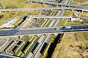 Nederland, Zuid-Holland, Rotterdam, 18-02-2015. A15 en knooppunt Benelux. Infrastructuur bundel, kruising Betuweroute en A15, metro en leidingenviaduct.<br /> Motorway A15 junction, connecting Port of Rotterdam with hinterland. Freight railway, subway, pipe overpass<br /> luchtfoto (toeslag op standard tarieven);<br /> aerial photo (additional fee required);<br /> copyright foto/photo Siebe Swart