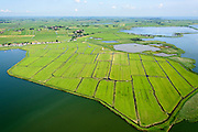 Nederland, Noord-Holland, Amsterdam, 05-08-2014; Polder IJdoorn, bij Durgerdam.  Rechts KInselmeer. Buitendijkse polder voormalige Zuiderzee.<br /> Polder outside the regular seawall, near Amsterdam.<br /> luchtfoto (toeslag op standard tarieven);<br /> aerial photo (additional fee required);<br /> copyright foto/photo Siebe Swart