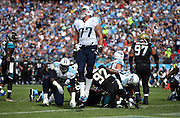 Tennessee Titans tackle Taylor Lewan (77) leaps and celebrates after Tennessee Titans running back Jackie Battle (44) runs for a second quarter touchdown that cuts the Jacksonville Jaguars lead to 10-7 during the NFL week 6 regular season football game against the Jacksonville Jaguars on Sunday, Oct. 12, 2014 in Nashville, Tenn. The Titans won the game 16-14. ©Paul Anthony Spinelli
