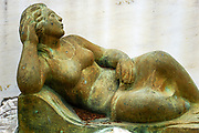 Statue of a reclining woman. Photographed in Athens