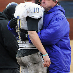 Staff photos by Tom Kelly IV<br /> West Chester QB Sean McCartney (10) gets a hug from head coach Bill Zwaan following the West Chester University at Lenoir-Rhyne University (Hickory, NC) NCAA Division II semifinal game, Saturday December 14, 2013.  WCU lost by a score of 42-14.
