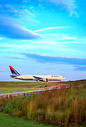 Delta airliner awaiting departure at Atlanta's Hartsfield Jackson International Airport.  October, 2008.  Created by aviation photographer John Slemp of Aerographs Aviation Photography. Clients include Goodyear Aviation Tires, Phillips 66 Aviation Fuels, Smithsonian Air & Space magazine, and The Lindbergh Foundation.  Specialising in high end commercial aviation photography and the supply of aviation stock photography for commercial and marketing use.