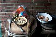Breakfast at the Cuis' includes fresh eggs from the family hens and hot mian tiao (noodles) with a little cooked spinach and MSG. The round chopping block is made from a slice of tree trunk, a common practice in China. Hungry Planet: What the World Eats (p. 89). The Cui family of Weitaiwu village, Beijing Province, China, is one of the thirty families featured, with a weeks' worth of food, in the book Hungry Planet: What the World Eats.