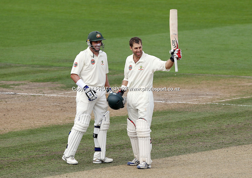 Australian batsman Simon Katich celebrates his century during the second innings as Michael Hussey looks on.<br />Test Match Cricket. 2nd test. Day 3.<br />New Zealand Black Caps versus Australia. Seddon Park, Hamilton, New Zealand. Monday 29 March 2010. <br />Photo: Andrew Cornaga/PHOTOSPORT