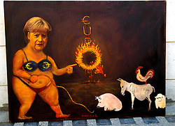Warning of content..German Chancellor Angela Merkel in depicted in the work called 'Euro Bank' by Spanish artist Kaya Mar, Westminster, London, UK, May 1 2013. Photo by: Max Nash / i-Images