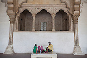 An Indian family is taking a break inside the Agra Fort, standing next to the heavily polluted and dry Yamuna River, in Agra. From this balcony inside the Fort, Mughal emperors used to address his men.