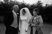 05/07/1967<br /> 07/05/1967<br /> 05 July 1967<br /> Wedding of George Walsh, eldest son of Mr and Ms Kevin G. Walsh, St. Rita's, Firhouse Road, Templeogue, Co. Dublin and Miss Arlene McMahon, elder daughter of Det. Chief Supt. Philip McMahon, Head of Special Branch, Dublin Castle and Mrs McMahon of Lisieux, Templeville Park, Templeogue, Co. Dublin who were married at the Carmelite Church, Terenure College, Dublin. An Taoiseach Mr Jack Lynch and Mrs Lynch; Mr Liam Cosgrave, leader Fine Gael and Mrs Cosgrave were among the 120 guests. Rev Fr H.E. Wright, O. Carm., Moate, officiated at the ceremony. The reception was held at Downshire Hotel, Blessington, Co. Wicklow. Bride with her parents.