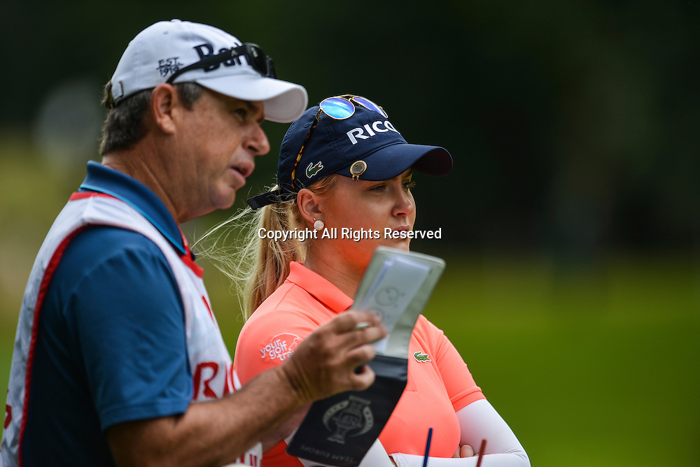 31.07.2016. Woburn Golf Course, Milton Keynes, England. Ricoh Womens Open Golf, final round. Charley Hull (England) talks with her caddy about distance.