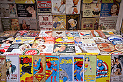 Magazines, cartoons, comics, Batman, Superman, Wonder Woman, Captain America and posters on sale at stall, New York, USA