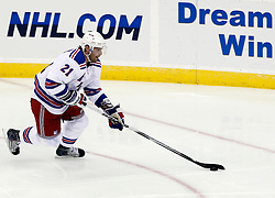 Oct 5, 2009; Newark, NJ, USA; New York Rangers left wing Christopher Higgins (21) skates with the puck during the third period at the Prudential Center. The Rangers defeated the Devils 3-2.