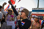 22 DECEMBER 2013 - BANGKOK, THAILAND: An anti-government protestors at a roadblock blocking the road to the home of Yingluck Shinawatra. Hundreds of thousands of Thais gathered in Bangkok Sunday in a series of protests against the caretaker government of Yingluck Shinawatra. The protests are a continuation of protests that started in early November and have caused the dissolution of the Pheu Thai led government of Yingluck Shinawatra. Protestors congregated at home of Yingluck and launched a series of motorcades that effectively gridlocked the city. Yingluck was not home when protestors picketed her home.     PHOTO BY JACK KURTZ