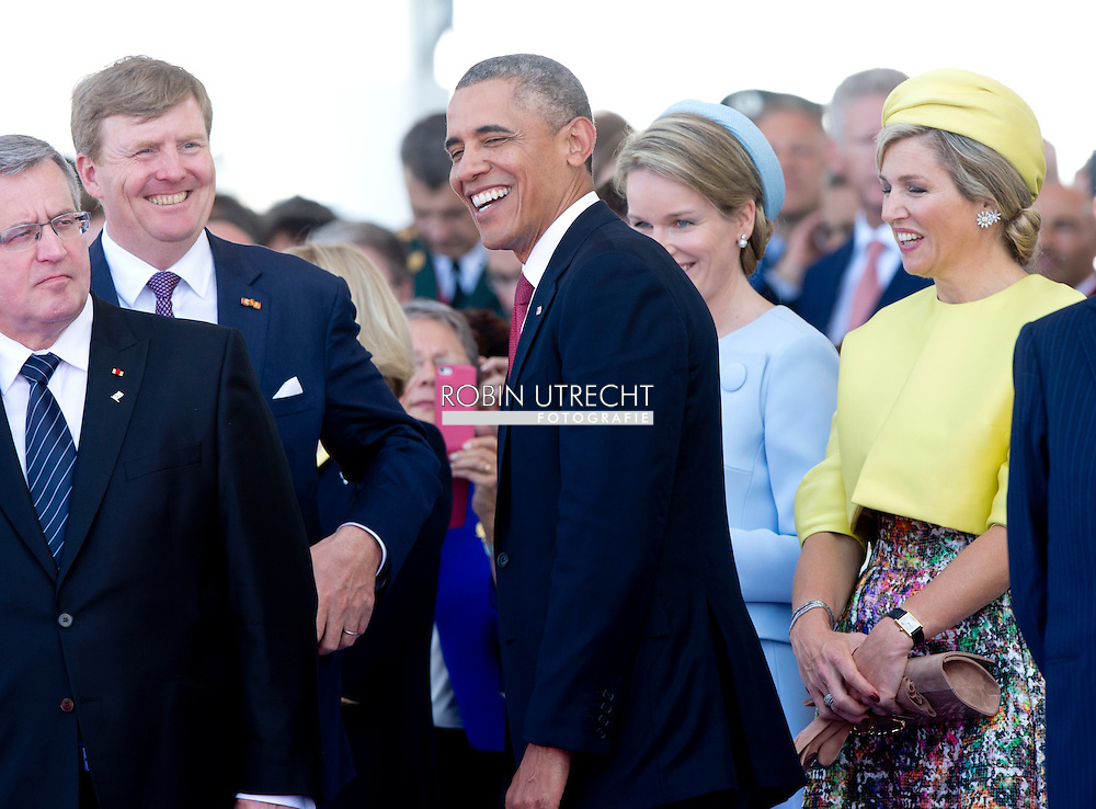 Queen Elizabeth and the Duke of Edinburgh of the United Kingdom, King Philippe and Queen Mathilde of Belgium, King Harald of Norway, King Willem-Alexander and Queen Maxima of The Netherlands, Queen Margrethe of Denmark, President Obama of the United States, President Putin of Russia President Hollande of France, chancellor Merkel of Germany, Prime Minister Cameron of the United Kingdom attend the D-Day commemoration to mark the allied invasion 70 years ago at Sword Beach, Ouistreham, France, 6 June 2014. COPYRIGHT ROBIN UTRECHT