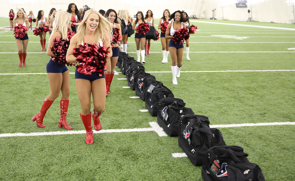 4/16/2014: Newly announce cheerleaders pick out their new Houston Texans cheer bags. Fifty girls showed up on April 16, 2014 at the Houston Texans practice facility in Houston, Texas to see which 35 girls made the 2014-2015, Houston Texans Cheerleading Team.
