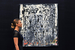 "© Licensed to London News Pictures. 23/06/2017. London, UK. A staff member views ""Split (Rubble)"", 1989, by Gerhard Richter (estimate GBP3.5-4.5m) at the preview of Sotheby's Contemporary Art Sale in New Bond Street.  The auction, which is dominated by Pop art, takes place on 28 June. Photo credit : Stephen Chung/LNP"