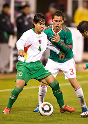 February 24, 2010; San Francisco, CA, USA;  Bolivia defender Marvin Bejarano (4) is defended by Mexico defender Paul Aguilar (3) during the second half at Candlestick Park. Mexico defeated Bolivia 5-0.