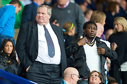 LIVERPOOL, ENGLAND - Sunday, August 30, 2009: Former Everton player Daniel Amokachi and Football DataCo's Derek Johnston watch from the stands as Everton take on Wigan Athletic during the Premiership match at Goodison Park. (Photo by David Rawcliffe/Propaganda)