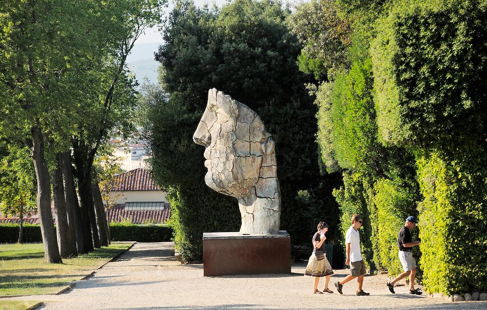 Tindaro Screpolato. Modern sculptured head by artist Igor Mitoraj in the Boboli Gardens, Florence, Italy