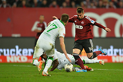 08.03.2014, easyCredit Stadion, Nuernberg, GER, 1. FBL, 1. FC Nuernberg vs SV Werder Bremen, 24. Runde, im Bild Robert Mak (1 FC Nuernberg / rechts) setzt zum Torschuss an Vorne links: Aleksandar Ignjovski (Werder Bremen) Am Boden: Assani Likimya (Werder Bremen) Action / Aktion // during the German Bundesliga 24th round match between 1. FC Nuernberg and SV Werder Bremen at the easyCredit Stadion in Nuernberg, Germany on 2014/03/08. EXPA Pictures © 2014, PhotoCredit: EXPA/ Eibner-Pressefoto/ Merz<br /> <br /> *****ATTENTION - OUT of GER*****