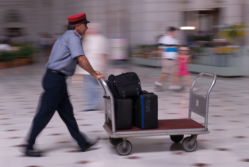 Man pushing luggage