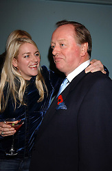 LAURA PARKER BOWLES and her father ANDREW PARKER BOWLES at a party to celebrate the publication of 'E is for Eating' by Tom Parker Bowles held at Kensington Place, 201 Kensington Church Street, London W8 on 3rd November 2004.<br /><br />NON EXCLUSIVE - WORLD RIGHTS