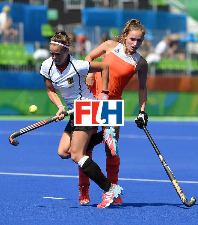 Germany's Pia-Sophie Oldhafer (L) vies with Netherlands' Kelly Jonker during the women's semifinal field hockey Netherlands vs Germany match of the Rio 2016 Olympics Games at the Olympic Hockey Centre in Rio de Janeiro on August 17, 2016. / AFP / Pascal GUYOT        (Photo credit should read PASCAL GUYOT/AFP/Getty Images)