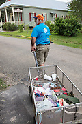 Adrian Juttner with tools and trash during the Trash Bash sponsored by Keep Abita Beautiful in Abita Springs, Louisiana
