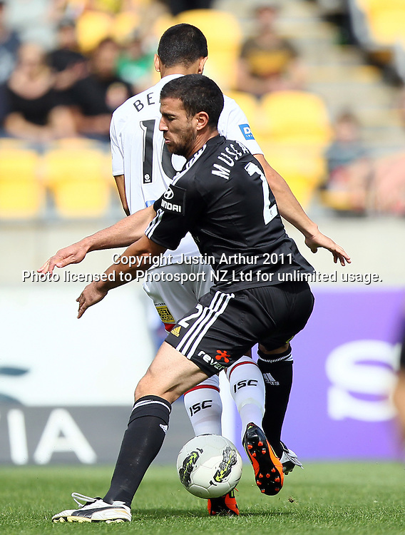 Phoenix's Manny Muscat runs into Melbourne's Aziz Behich. A-League football - Wellington Phoenix v Melbourne Heart at Westpac Stadium, Wellington, New Zealand on Sunday 29 January 2012. Photo: Justin Arthur / Photosport.co.nz
