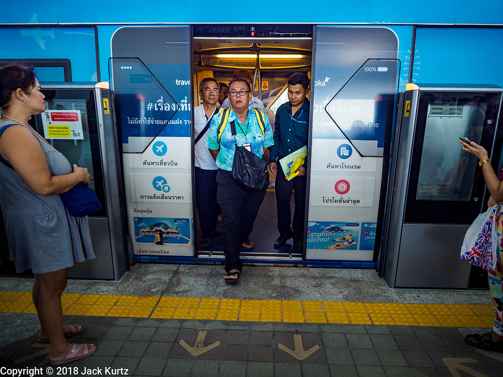 06 DECEMBER 2018 - SAMUT PRAKAN, THAILAND:  Passengers get off a train on the expansion of  BTS Skytrain in Samrong station. The 12.6 kilometer (7.8 miles) east extension of the Sukhumvit Line of the Bangkok BTS Skytrain goes into Samut Prakan, a town east of Bangkok.  The system is now 51 kilometers long (32 miles), including the 12.6 kilometer extension that opened December 06. About 900,000 people per day use the BTS.      PHOTO BY JACK KURTZ