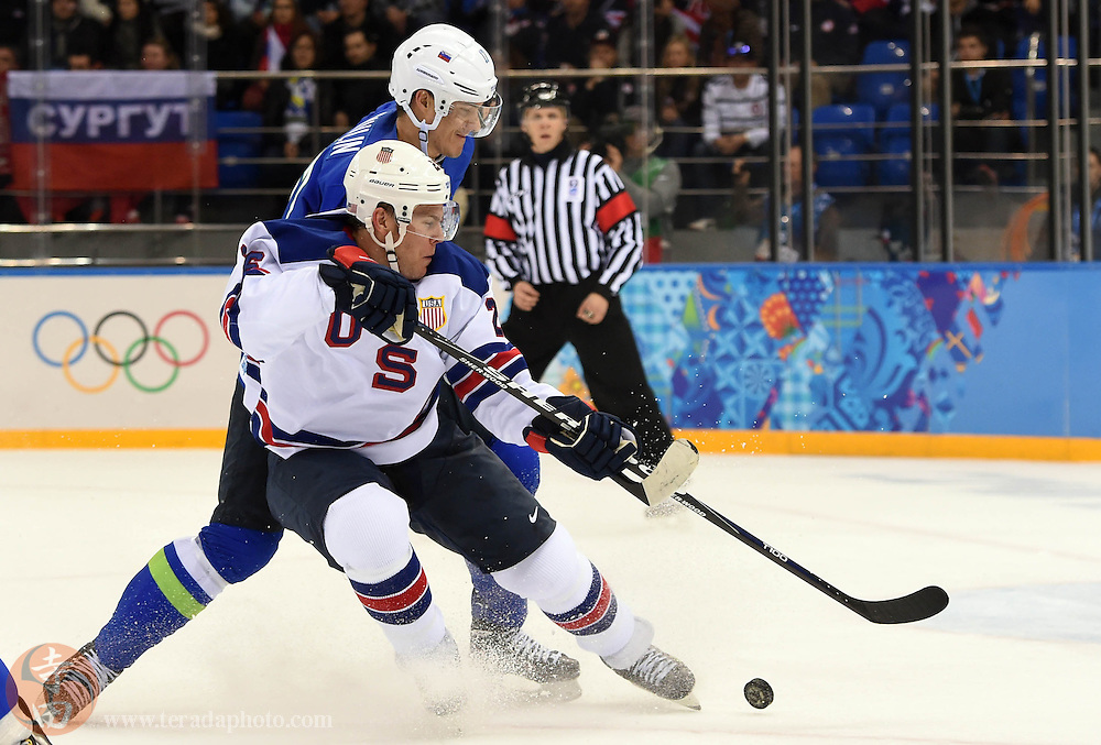 Feb 16, 2014; Sochi, RUSSIA; USA forward Paul Stastny (26) battles for the puck with Slovenia defenseman Ziga Pavlin (17) in a men's ice hockey preliminary round game during the Sochi 2014 Olympic Winter Games at Shayba Arena.
