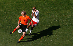 14.06.2010, Soccer City Stadium, Johannesburg, RSA, FIFA WM 2010, Niederlande vs Dänemark im Bild Dirk Kuyt of Netherlands fliclks the ball on past Simon Poulsen of Denmark, EXPA Pictures © 2010, PhotoCredit: EXPA/ IPS/ Mark Atkins / SPORTIDA PHOTO AGENCY