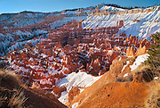 "Bryce Canyon, Utah.  After sunrise, I climbed along the edge of the canyon, up towards the deeper snow up on the rim, looking into the coliseum below me.  The hoodoos of the Claron formation, an oxidized mudstone, were lighting up in pink and orange hues, some almost translucent as the sun reflected off the snow and bounced crazily off the rock.  In this anthropomorphized place, this area is part of the Silent City.  Paiute history says these were ""Legend People"" who were turned into stone for bad deeds.  I wondered if I could tiptoe down the little exposed ridge just below me, to stand at the edge with my arms outstretched, while the silence deafened me from the amphitheater.   I would make no speech, no signal for the trumpets, no lighting of the torches.  I'd stare awhile, then spin and walk back up.  Let the games begin.  They've been here long enough, awaiting the gladiators."