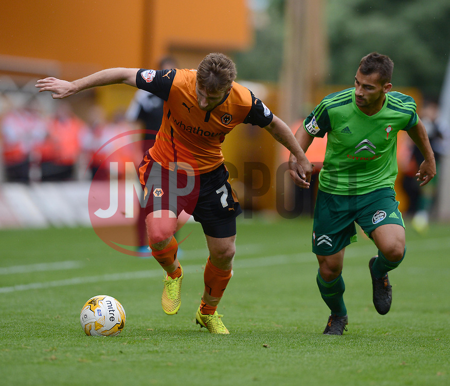 Wolverhampton's James Henry attacks down the wing under pressure from   - Photo mandatory by-line: Alex James/JMP - Tel: Mobile: 07966 386802 2/08/2014 - SPORT - FOOTBALL -  Wolverhampton - Molineux Stadium  -   Wolverhampton vs  Celta Vigo - preseason